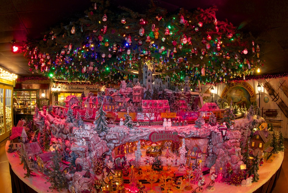 Figure 4: This large toy train exhibit at the National Christmas Center, decorated with 3,000 Christmas tree ornaments, was inspired by Jim Morrison's childhood memories of his own train and tree.
