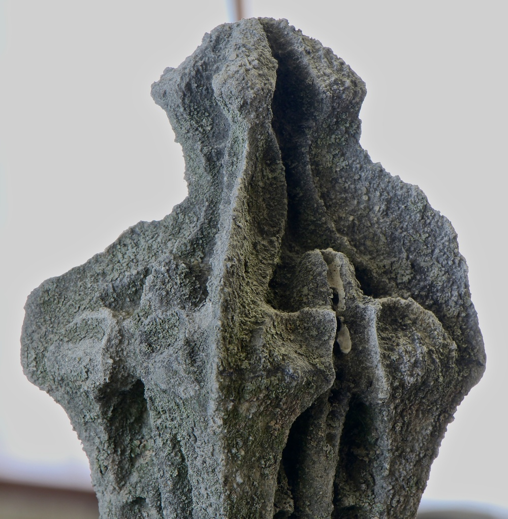Figure 3: The level of decay on this limestone finial has reached the point that details are beginning to disappear. At this point it becomes necessary to replace the entire finial with a modern exact copy in Indiana limestone, which is stronger than the original limestone used for Bryn Athyn Cathedral.