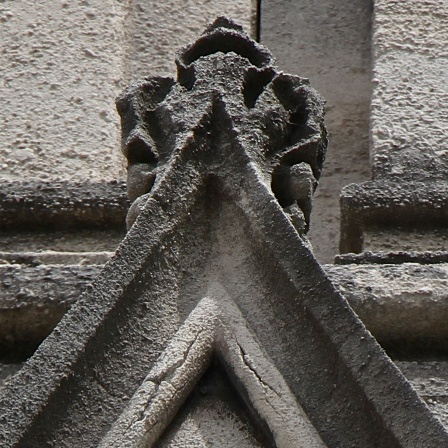 Figure 4: Existing stone on the south wall is showing cracks in the molding, and will need re-carving in the next year or two.