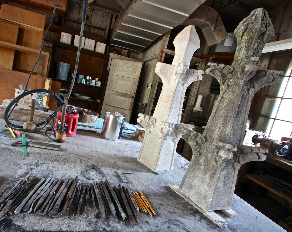 Figure 5: In the Bryn Athyn Cathedral workshops, a new limestone finial (left) is in the process of being carved. This is an exact copy of the original, degraded finial (right).
