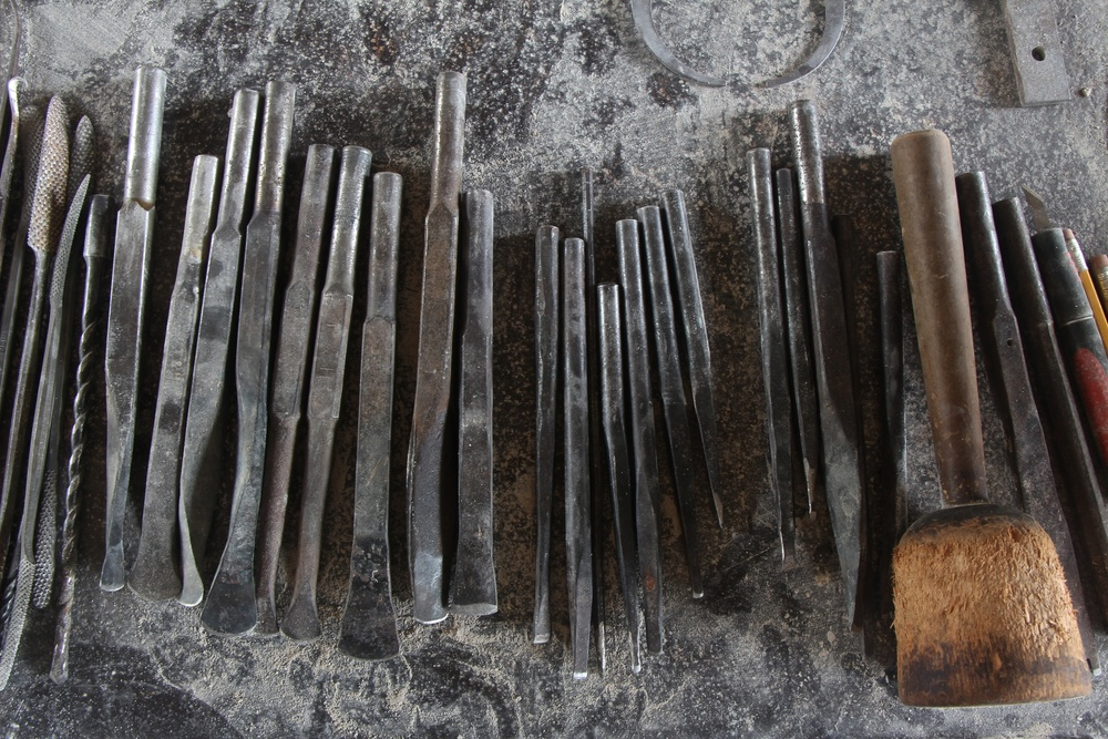 Figure 6: A variety of chisels and rasps are used with a wooden mallet for detail carving.