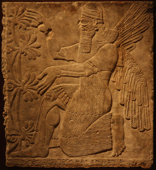 Winged bearded guardian figure wearing a horned helmet, from the Northwest Palace of Assurnasirpal II in Nimrud, Iraq.