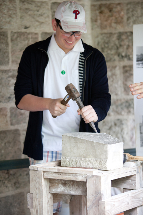 A Visitor Tries His Hand at Stone Carving