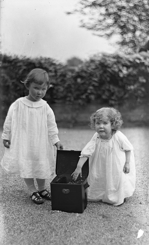 Nathan and Gabriele Pitcairn, circa 1915, Posing with Their Father's Camera Box