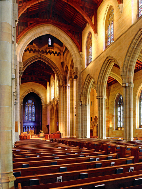 The interior of Bryn Athyn Cathedral's nave from the west end looking toward the chancel in the east (from page 7 of Bryn Athyn Cathedral: The Building of a Church). Photograph by Hal Conroy.
