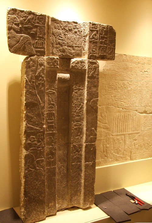 "The spirit door of Tep-em-ankh, on loan from Glencairn Museum, in its place beside a relief with the tomb owner's ""menu list"" (right), which is on loan from the Louvre Museum."