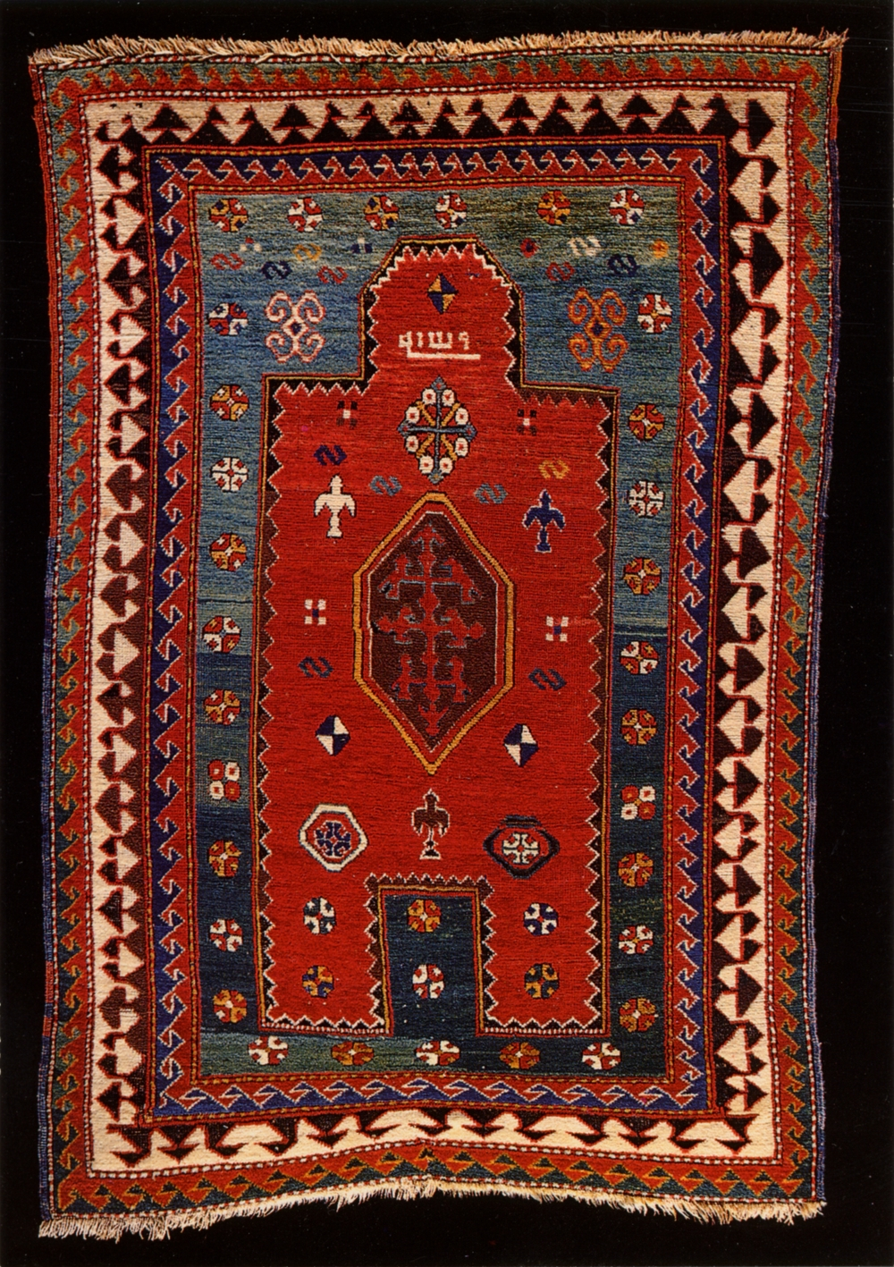 Islamic prayer rug with mihrab