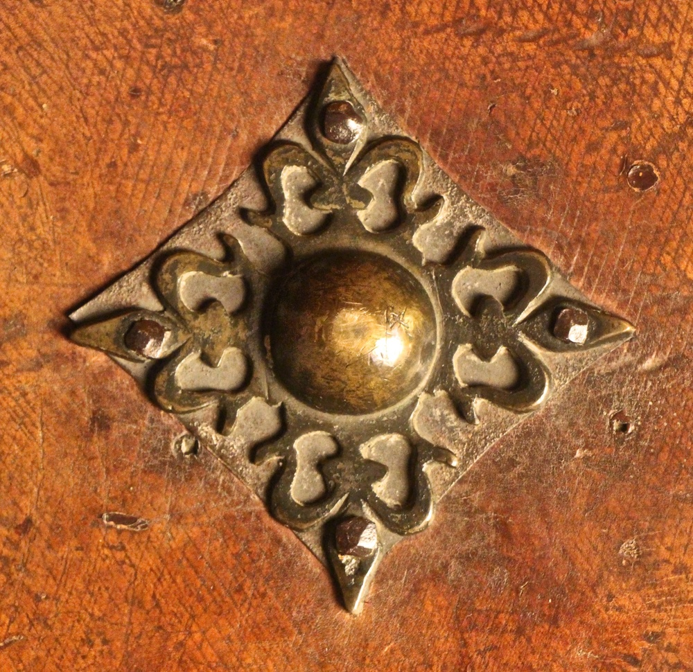 Figure 5: One of several pieces of metalwork on the cover of the manuscript that appears to reference its connection to the Order of Calatrava. Note the similarity to Figure 6.