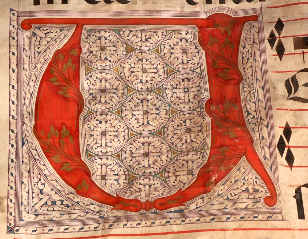 "Figure 9: One of the three large illuminated letters that show the height of artistic detail in this manuscript, the ""V"" on folio 59v begins the section of hymns."