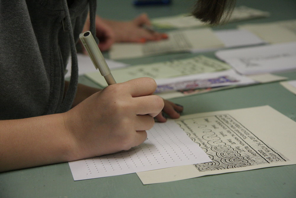 Visitors practice their penmanship.