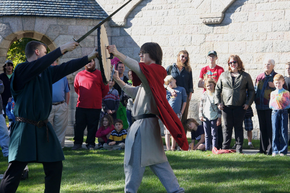 Two knights demonstrate their skills for onlookers.