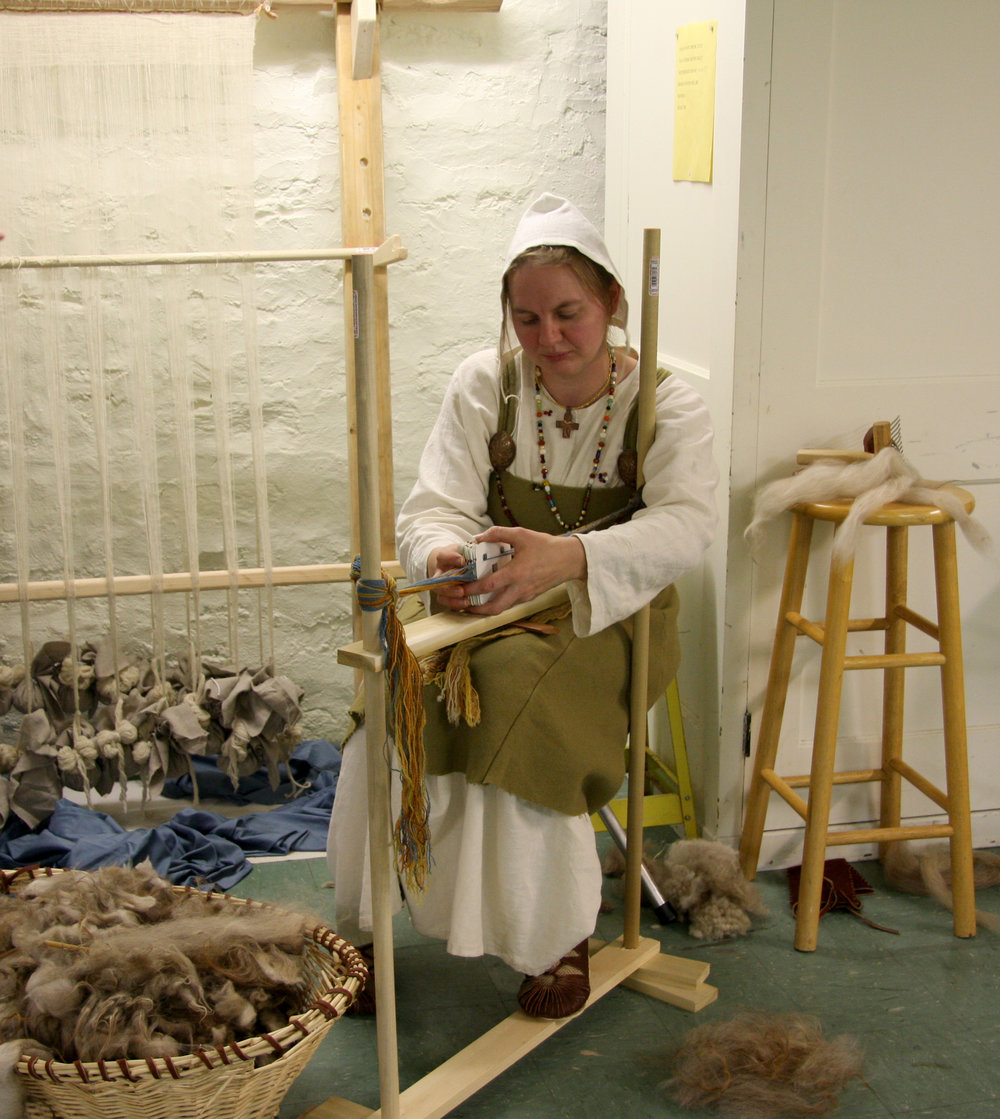 Eva Mergen demonstrates wool working.