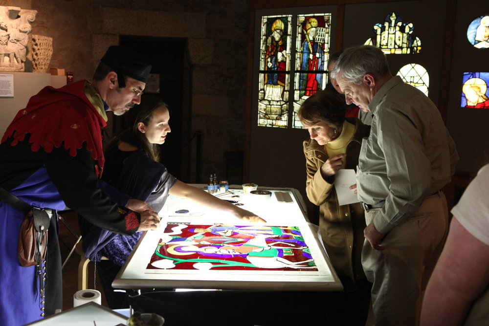 Stained glass artist J. Kenneth Leap and  Bryn Athyn College  students talk with visitors about stained glass painting and design.