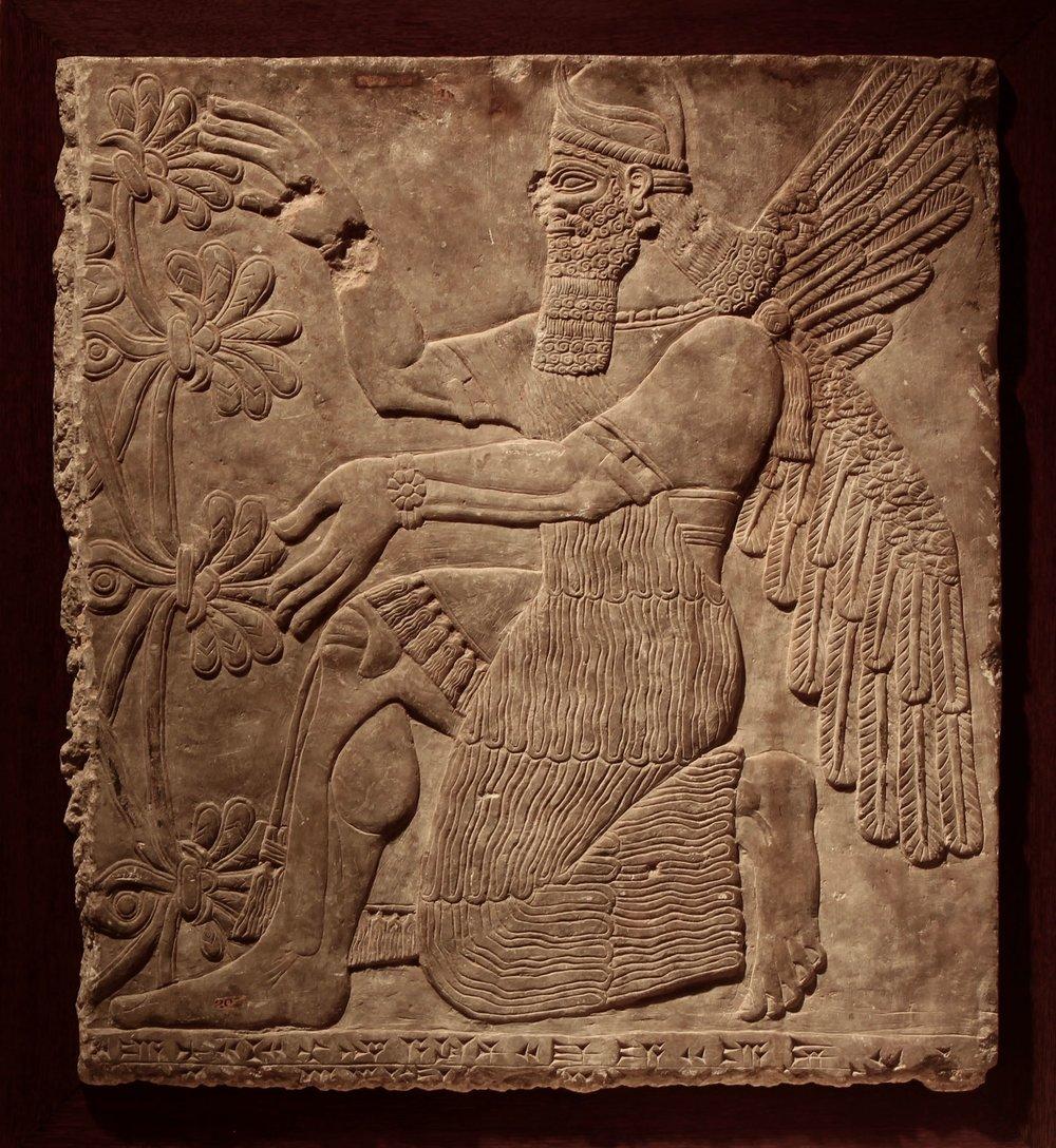 Figure 2: A kneeling genie, Northwest Palace of Ashurnasirpal II at Nimrud, Iraq. (09.SP.1549; 77 x 68.5 cm)