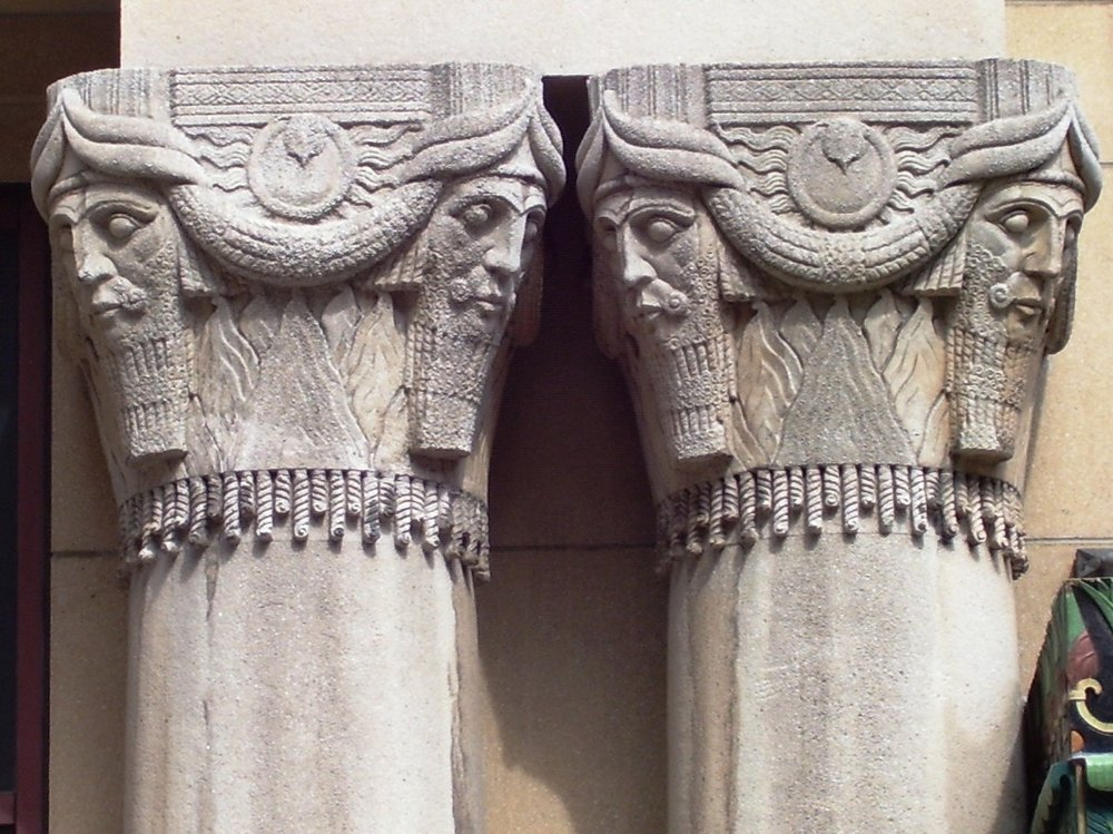 Figure 8: Heads inspired by Neo-Assyrian colossal bulls (and iconographically similar to the genies at Glencairn) on the Pythian Temple in New York City, a lodge for members of the fraternal organization The Knights of Pythias. The art deco building drew heavily from on-trend Egyptian and Assyrian artistic motifs. (Photo by Beyond My Ken, via Wikimedia Commons.)