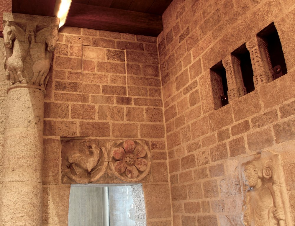 Figure 9: Raymond Pitcairn chose to exhibit one of his Assyrian reliefs in the northwest corner of the Great Hall of Glencairn: a royal eunuch attendant from the Central Palace of Tiglath-Pileser III (Figure 3). However, originally the space seems to have been prepared for the square frame of the smaller relief of the head of the genie from the Northwest Palace of Ashurnasirpal II (Figure 1). A square, recessed niche is still visible above the open doorway. At some point the relief was removed, and now all five Assyrian reliefs are on exhibit in Glencairn's Ancient Near East gallery. Pitcairn also displayed three Assyrian reliefs in his personal office in Glencairn's basement.