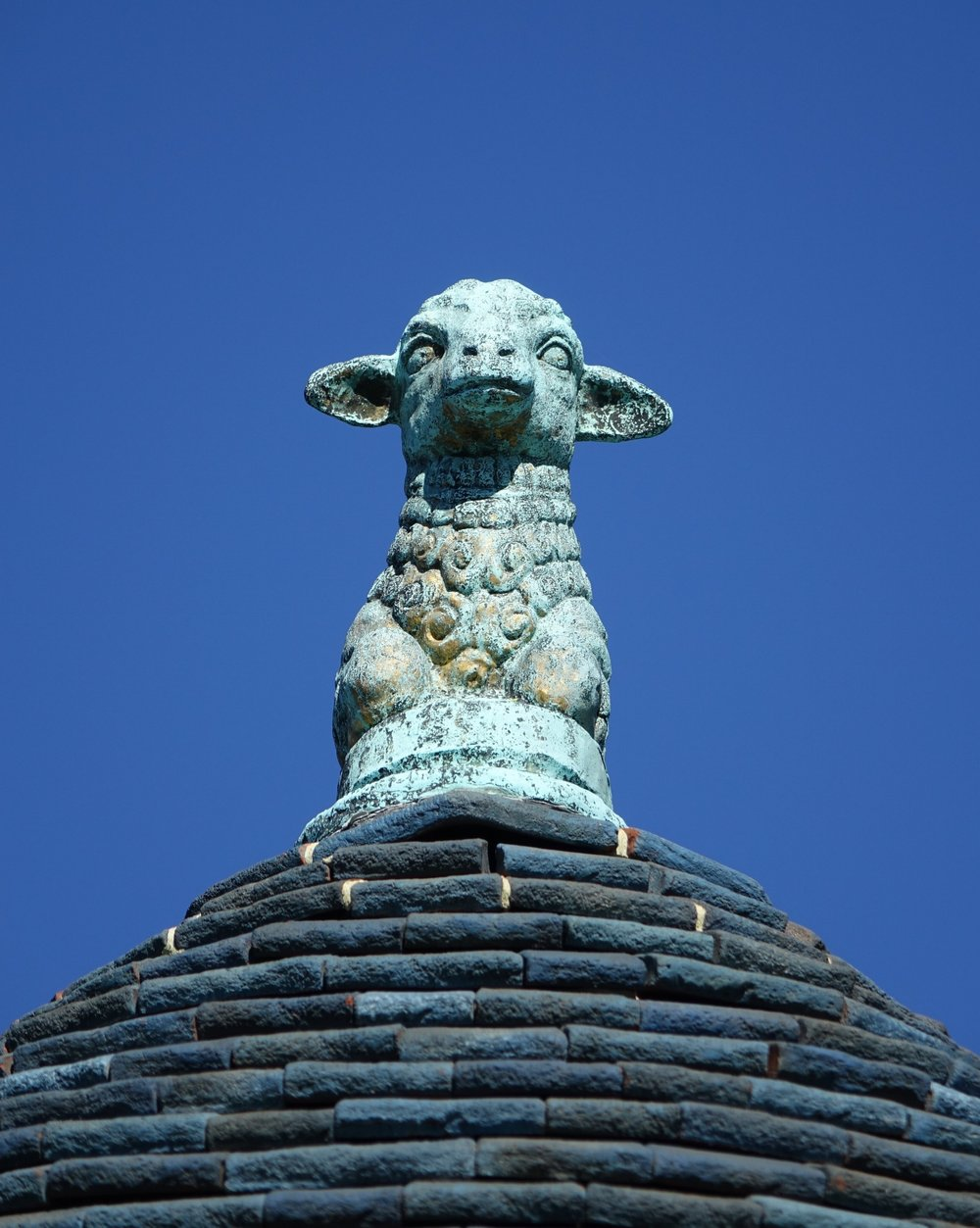 Figure 3: This metalwork lamb sculpture is perched on top of the roof of the upstairs living room.