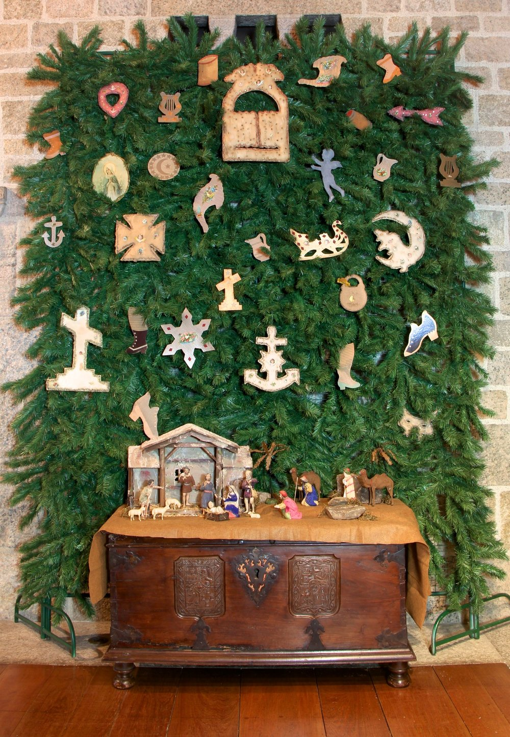 Figure 2: During the late 19th century, some Pennsylvania Dutch families would create an evergreen bower in their parlor or dining room to display their Christmas ornaments. The bower, which might cover three walls of the room as well as the ceiling, sometimes took the place of a Christmas tree. Ornaments and late 19th-century German Nativity are on loan from the National Christmas Center and Museum, Lancaster, PA.