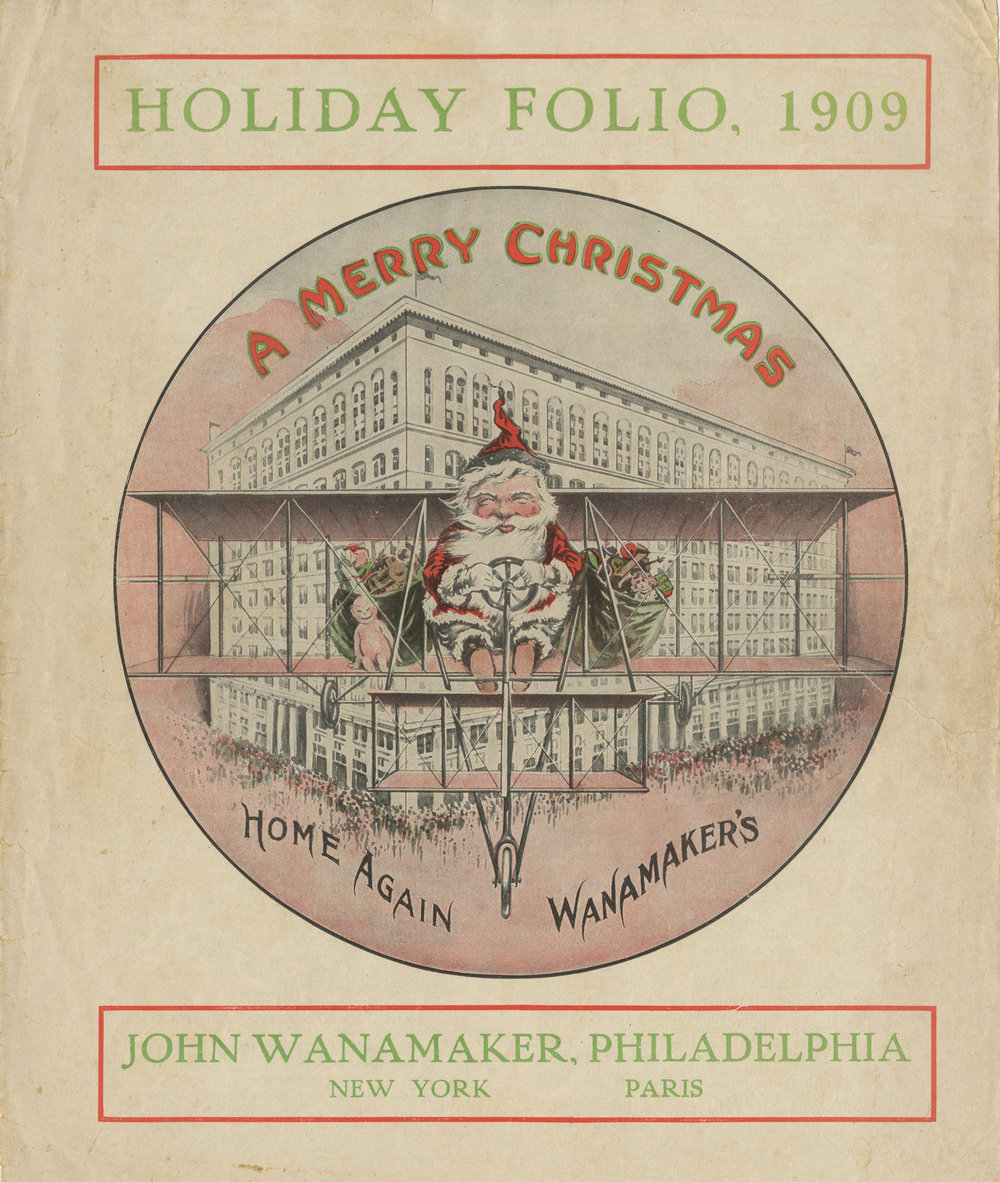 Figure 11: Wanamaker's Christmas giveaway booklet for 1909 shows Santa arriving in a Herring-Curtiss Flying Machine, which was on display inside the store the previous summer. On loan from the National Christmas Center and Museum, Lancaster, PA.