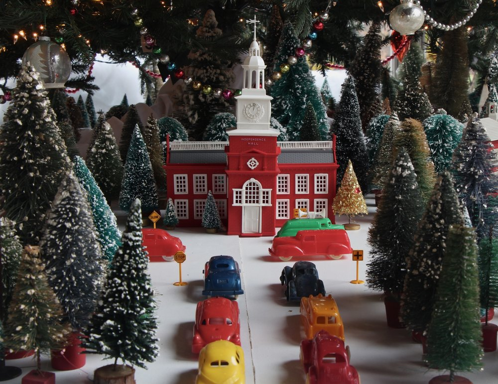 Figure 17: The 1950s Plasticville city beneath Glencairn's tree this year, featuring Philadelphia's Independence Hall, is on loan from the National Christmas Center and Museum in Lancaster, PA.