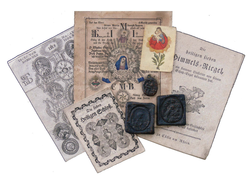 "Figure 9: Clockwise Right: European Breverl, Austrian dialect for a little protective letter, featuring the Caravaca Cross, 18th century; colored etching Glückselige Haussegen (Sacred House Blessing) with the Virigin Mary and the monograph of the Three Kings, CMB, and the Segen-Stern, a six-pointed star with the letters IEHOVA spread across the points, 19th Century, Munich; small Gnadenbild (Holy Image) of the Virgin Mary, which was physically touched to the Holy Image of the Virgin Mary in Passau, Lower Bavaria,(38) 18th century; Die heiligen sieben Himmels-Riegel (The Seven Holy Bars of Heaven), a protective prayer allegedly given to a hermit by his guardian angel, Cologne, Germany; three Fraisen-Steine (Epilepsy Stones) cast from zinc with images of the saints, carried by epileptics for deliverance from seizures; Die sieben Heiligen Schloß. (The Seven Holy Seals) a seven-fold prayer for protection, claiming to have been printed ""on the German press in Jerusalem,"" 19th century. Heilman Collection of Patrick J. Donmoyer."