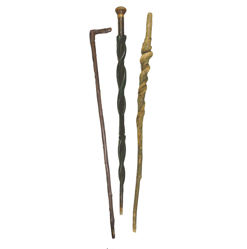 "Figure 4: Left: A powwower's cane, also called a ""throw-stick,"" used as a wand for healing and divination, Montgomery County, PA. Heilman Collection of Patrick J. Donmoyer. Middle: A cane wrapped with four carved serpents, used by a powwower from Hamburg, Berks County. Courtesy of the Mercer Museum, Doylestown, Pennsylvania. Right: A naturally formed spiral cane from vine, used as a powwow cane in Berks County. Courtesy of the Mercer Museum, Doylestown, Pennsylvania."