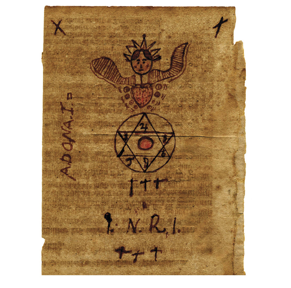 "Figure 16: Early Protective Blessing, 18th century—Heilman Collection of Patrick J. Donmoyer. Personal protective blessing produced in black and red ink on the verso of an unidentified, 18th-century Philadelphia printed estate document. Features a winged angel with a burning heart and crown, associated with the mystical vision of the Sophia or feminine aspect of the Holy Spirit, popular among certain Pietist groups in early Pennsylvania. The angel oversees the six days of creation, depicted within the Star of David, with planetary symbols within each point and the sun in the center. However, Mars is missing, and replaced by a ""J""—possibly an intentional inversion of martial influence as a protection from violence. The inscription I.N.R.I. (Iesus Nazarenus Rex Iudeorum—Jesus of Nazareth, King of the Jews) is a common protective inscription, flanked above and below with three crosses, symbolic of the Holy Trinity. Adonai, a Hebrew name for God meaning Lord, is inscribed on the left. Creases indicate it was folded and carried on the person."