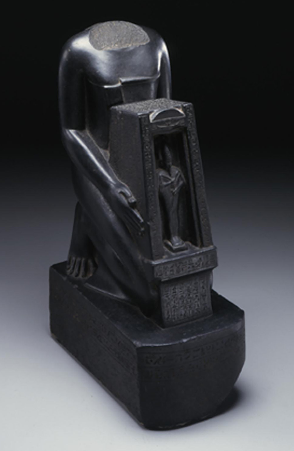 Figure 7: A Saite official, Psamtik-sa-Neith, holds a  naos  (shrine) containing an image of the god Osiris. Photo courtesy of the University of Pennsylvania Museum of Archaeology and Anthropology [UPMAA 42-9-1].