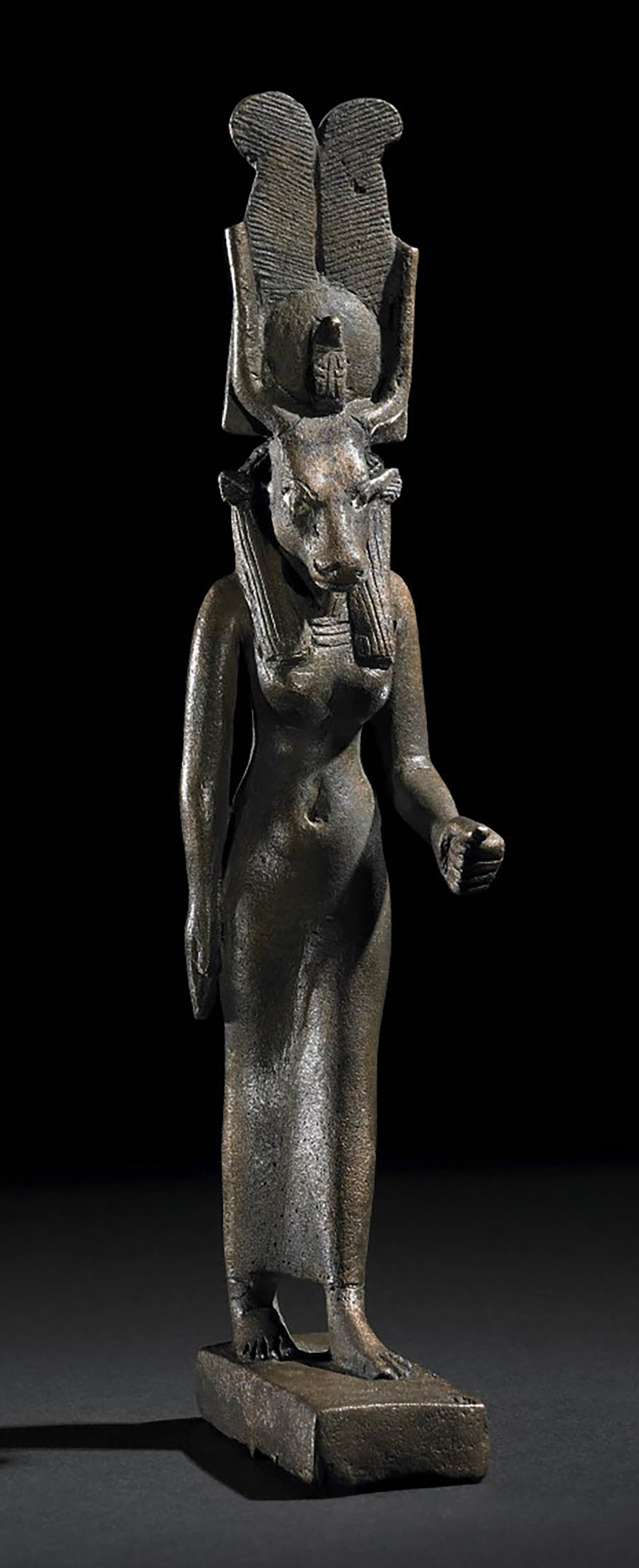 Figure 21: Here Hathor appears with the body of a female human with a bovine head. She wears the horned sundisk crown with two tall plumes. Image courtesy of The British Museum [EA22925].