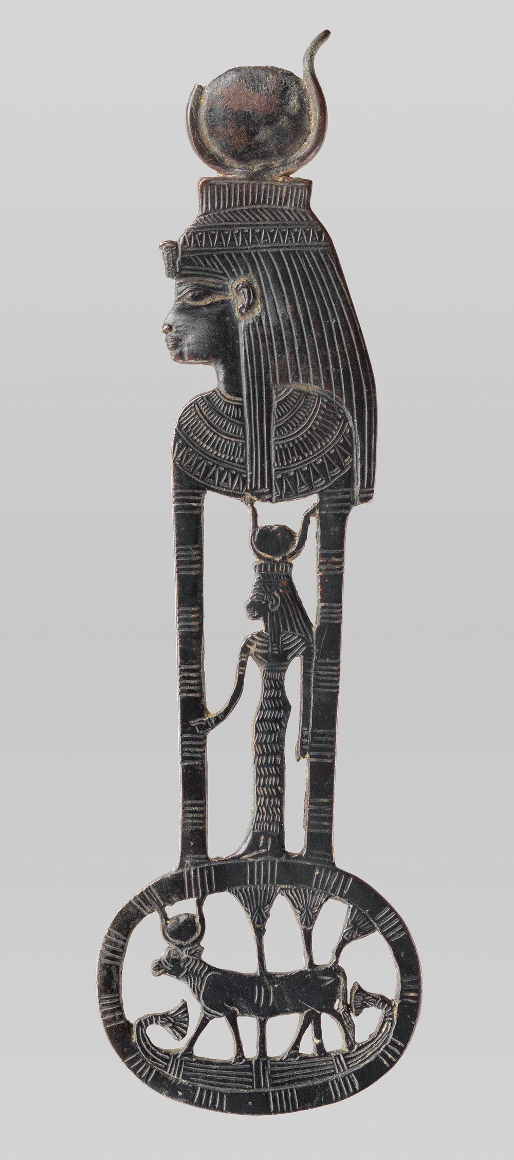 Figure 22: This menat, or necklace counterpoise, depicts the goddess Hathor both in the form of a woman wearing a horned sundisk crown and as a cow wearing a similar headgear. Image courtesy of the Metropolitan Museum of Art [51.157.2, Rogers Fund, 1951].