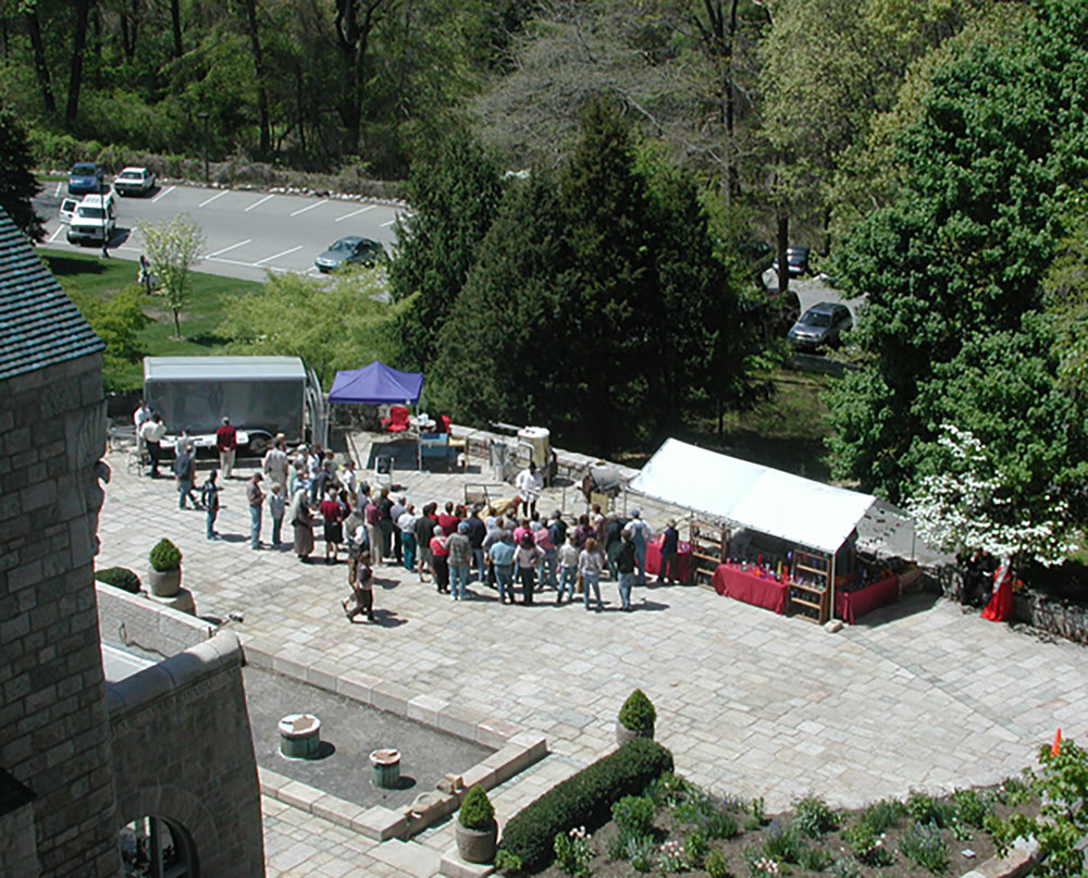 Figure 3: The Historical Glassworks glassblowing area at Glencairn in 2006, the first year of demonstrations. On the first year of the event there was no tent to cover the furnace in case of rain.
