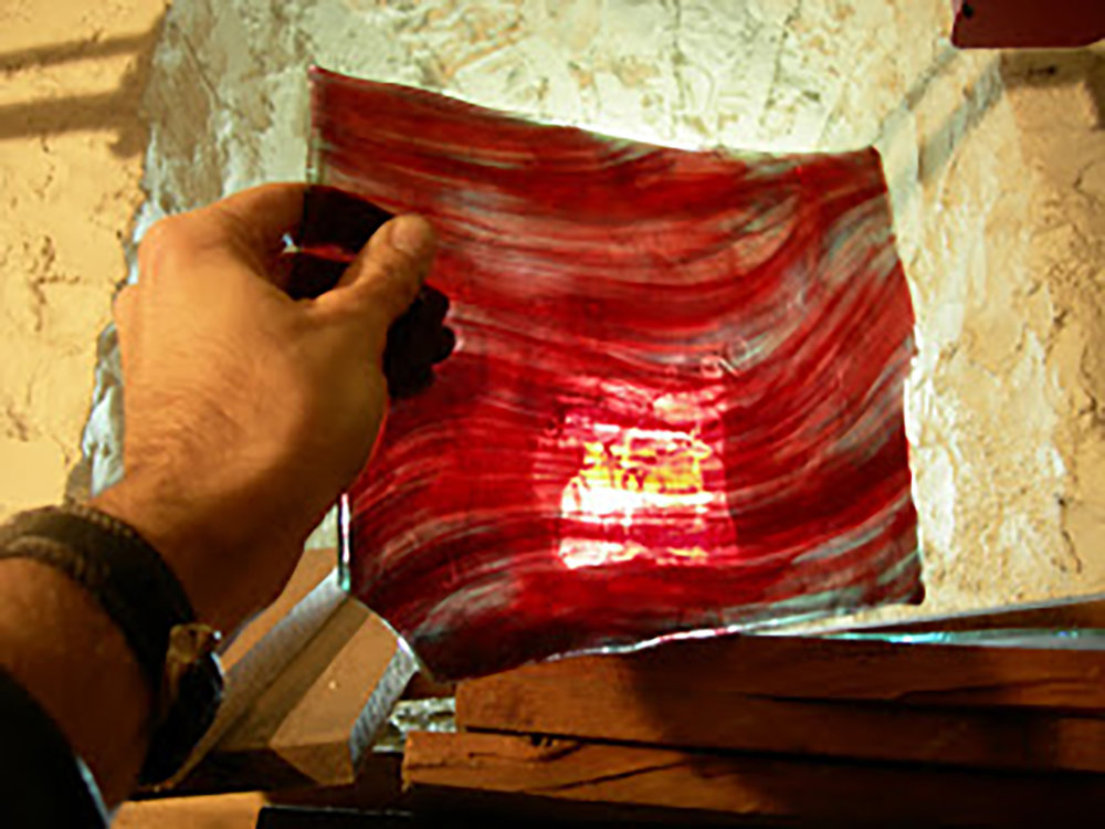 Figure 7: A panel of the Bryn Athyn red streaky glass, also known as striated ruby. Recreating this color of medieval glass was one of the more difficult challenges at the Bryn Athyn glassworks early in the 20th century.Photograph by J. Kenneth Leap.