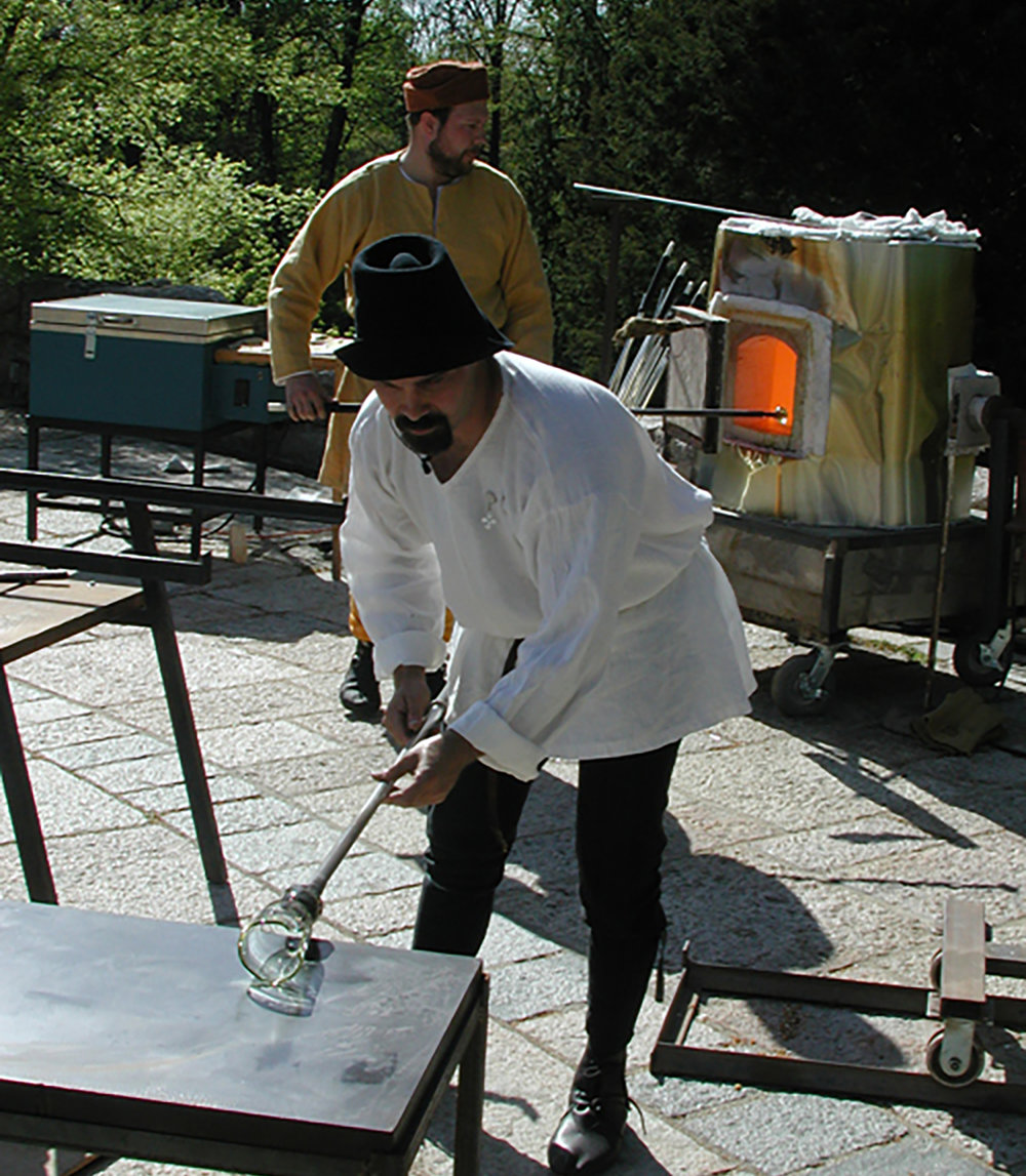 Figure 11:Jason Klein demonstrates the techniques used in the cylinder method of blowing glass. Photograph taken in 2006.