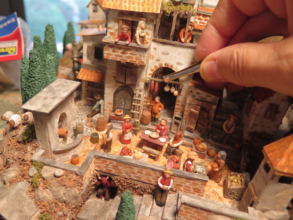 Figure 4: The use of tweezers was necessary to place many of the smallest items in this Nativity scene, set in a bustling Italian village. Photo by R. Michael Palan.