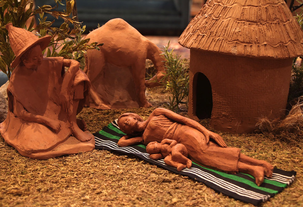 Figure 7: This Nativity was sculpted in Ghana by Mohammed Amin. Amin, a member of the Dagomba tribe, depicts Mary and Joseph as Dagomba. The hut, typical of northern Ghana, is made of mud and has a thatched roof. In 1996 one of Amin's Nativities won first place in Bellingham, Washington, at the International Creche Festival. On loan from the Knights of Columbus Museum, New Haven, Connecticut.