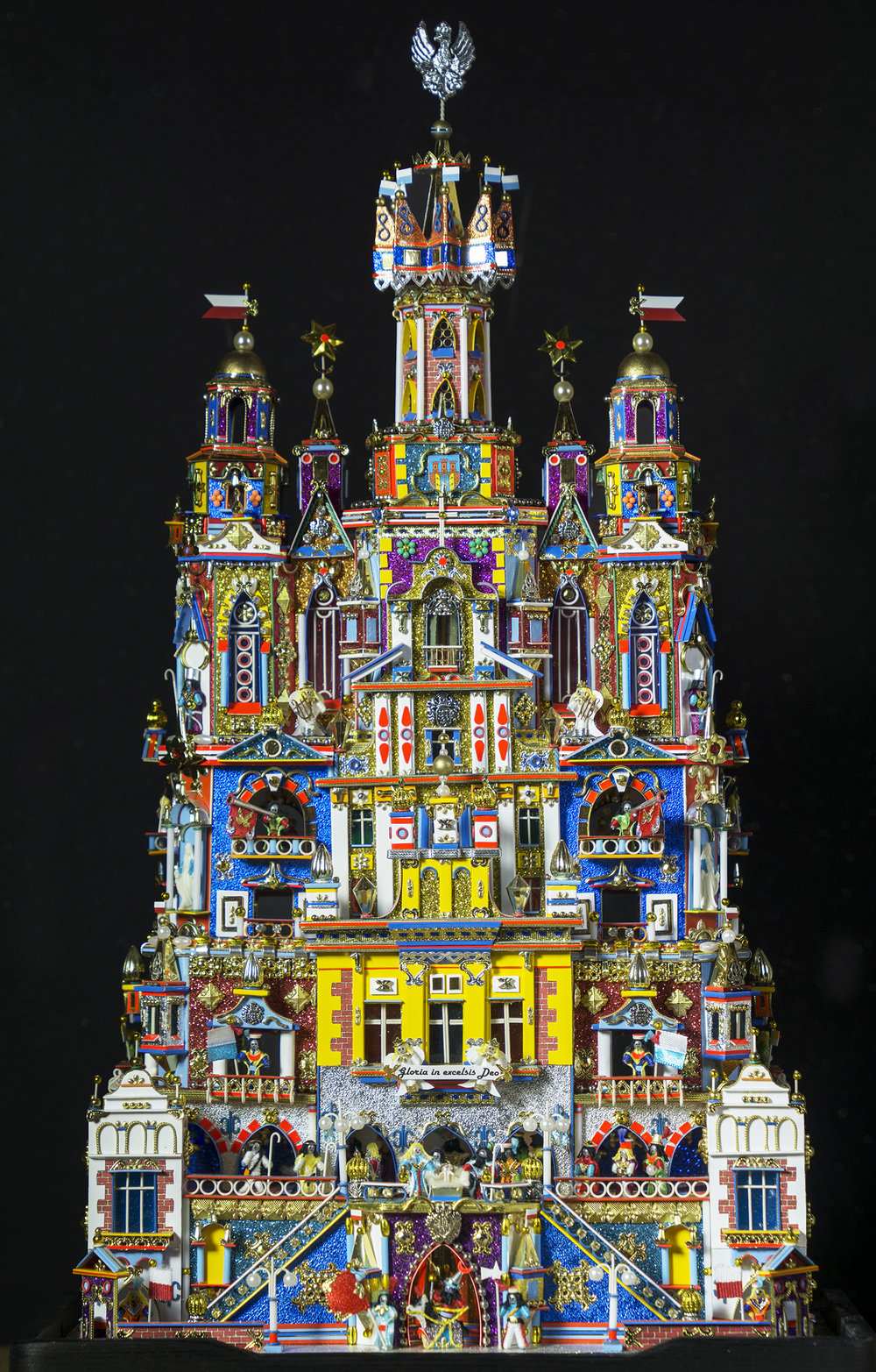 Figure 14: This Nativity, known as a szopka, was made in Poland by Kazimierz Stopinski. The unique folk tradition of the szopka dates to the late 18th and early 19th centuries, with the portable theaters made for Nativity puppet plays. It takes the form of an elaborate building facade in which the tiny figures of the Holy Family are surrounded with fanciful architectural features similar to those seen on Krakow's historic buildings. Every year since 1937 a szopka-building competition has been held in Krakow's market square. Stopinski has won first prize three times for his entries (medium and small category), most recently in 2015. On loan from the Knights of Columbus Museum, New Haven, Connecticut.