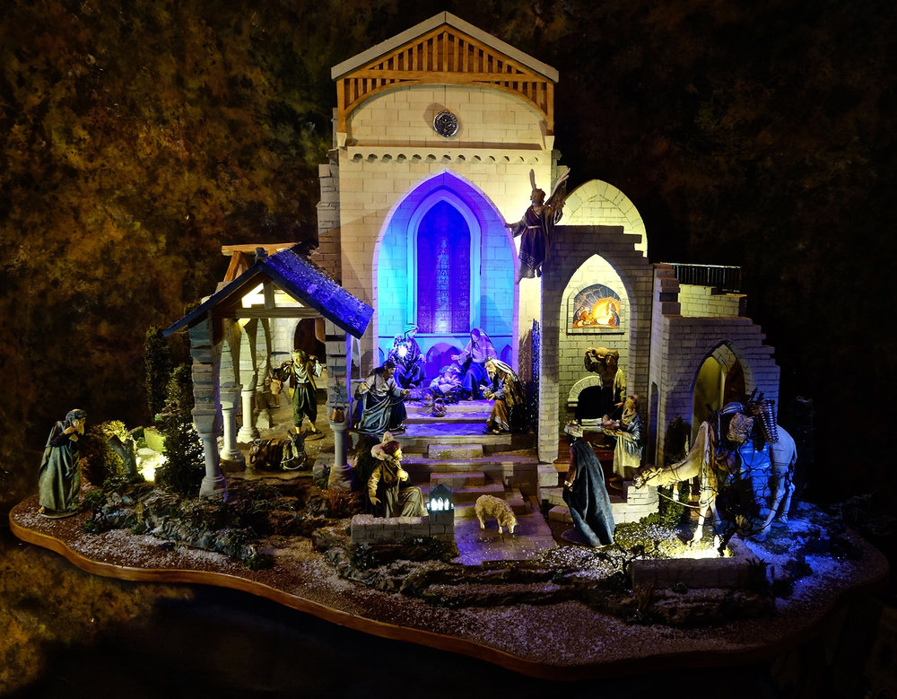 "Figure 22: The ""Christmas in the Castle"" tour features a unique creation by  Navidad Nativities  of Bucks County, Pennsylvania. This custom Nativity setting was inspired by the art and architecture of Bryn Athyn Cathedral and Glencairn. The human and animal figures were hand carved in wood and dressed in starched fabric by Original Heide, a family business in the Italian Alps."