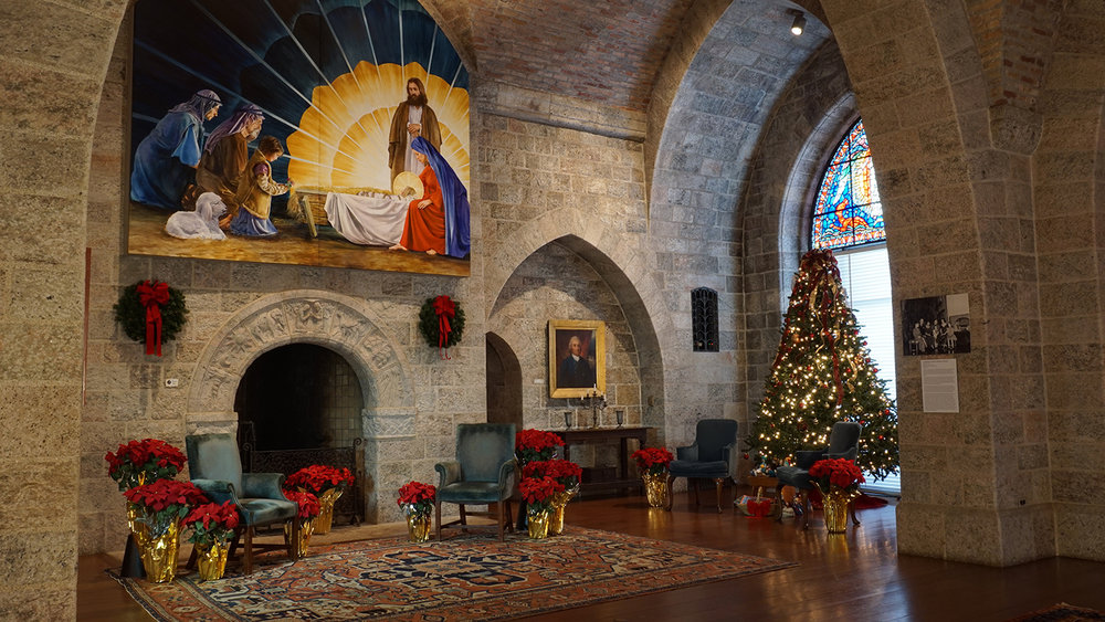 Figure 4: The Upper Hall of Glencairn decorated for Christmas in 2016; the Adoration of the Shepherds hangs above the Days of Creation fireplace. Wreaths and poinsettias, the latter grown in the Pitcairns' greenhouse next door at Cairnwood, were important elements in their Christmas decorating style.