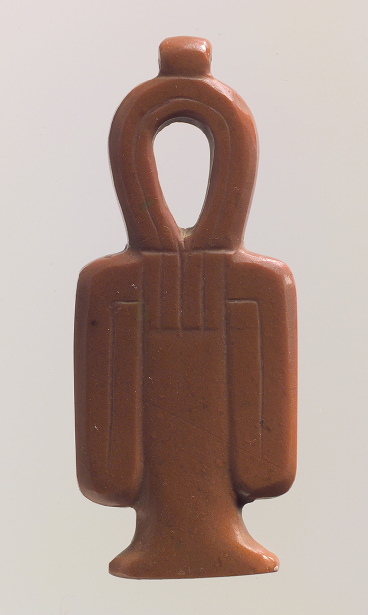 Figure 2: Red jasper  tyet  amulet from the site of Abydos (see also Figure 1). Image courtesy of the Metropolitan Museum of Art, 00.4.39.