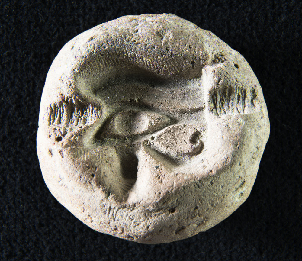 Figure 5: Faience amulets were often mass-produced in ceramic molds, such as this example in Glencairn Museum (E522) depicting a  wedjat  eye.