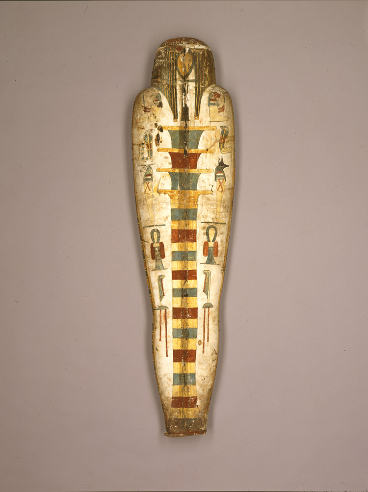Figure 20:   Djed  Pillar .   Representations of    Djed  pillars first appear in the late Old Kingdom (ca. 2350 BCE) and were often placed within the wrappings of a mummy to ensure protection for the deceased (see Figures 18, 19). The back of this cartonnage mummy case of a priest named Nebnetcheru features a large image of a  djed  pillar, which would provide magical protection for his body. Image courtesy of Penn Museum, E14344B.