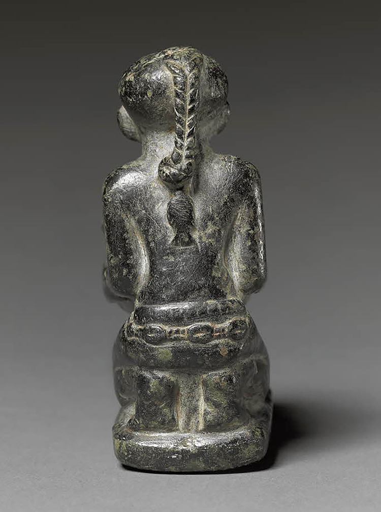 Figure 22:  Fish .   A famous Egyptian tale describes a young woman who is upset at losing her fish pendant in the water while taking part in a royal boating party. She refuses to row until she gets her fish pendant back. A lovely cosmetic jar in the British Museum (EA2572) shows a fish-shaped pendant affixed to the braid of a kneeling young woman (see also Figure 21). Image courtesy of the British Museum.
