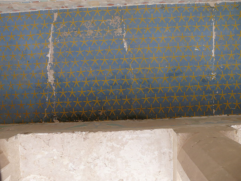 Figure 31:  Stars . Here a field of yellow stars on a blue background decorates the ceiling in a chamber in Hatshepsut's mortuary temple at Deir el Bahri. While the star is common in architectural decoration, its appearance as an amulet is not (see Figure 30).   Image © Ad Meskens/ Wikimedia Commons.