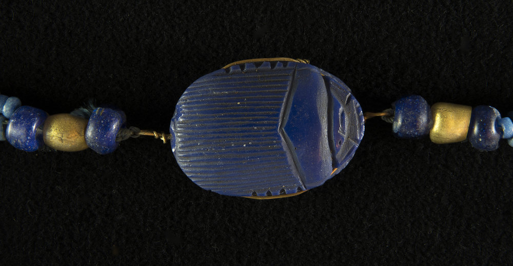 Figure 35: This somewhat stylized scarab amulet is made of lapis lazuli. Glencairn 15.JW.298.