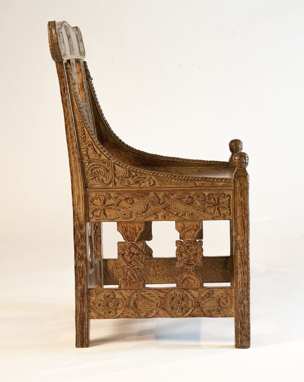 "Figure 1: A side view of Glencairn's ""Tyldal chair."" The intricate design on the right vertical spindle was copied from the original twelfth-century Norwegian chair."