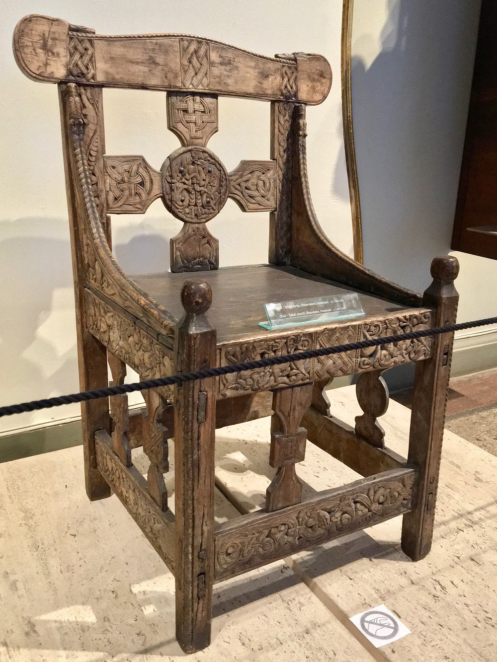 Figure 2: The original twelfth-century Tyldal chair, photographed in the Medieval Exhibition Room (middelalderutstillingen) at Kulturhistorisk Museum, Oslo, Norway. Photo © User: Wolfmann / Wikimedia Commons.