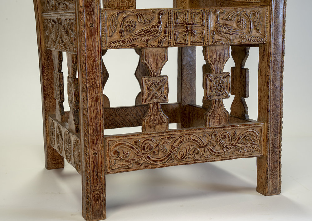 Figure 7: Front of Glencairn's chair. The design at the center of the left vertical spindle is copied from the original Tyldal chair. Elements of the design on the bottom stretcher of Glencairn's chair, especially the feather-like carvings, also exhibit some similarities to the original.