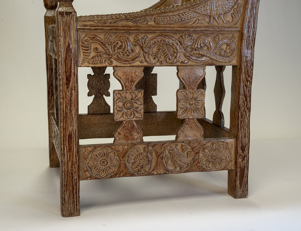 Figure 12: The right side of Glencairn's chair features a variety of carvings, including a turkey and a rooster, but no specific designs were copied from the Tyldal chair.