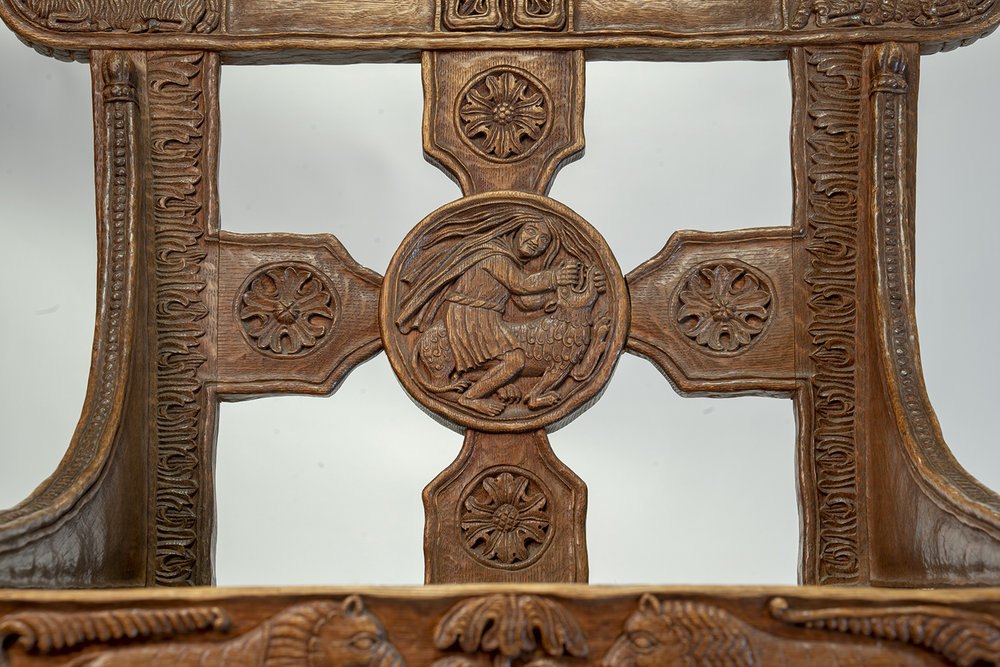 Figure 15: Bryn Athyn Cathedral Tyldal-style chair with a depiction of Samson slaying a lion (Judges 14:5) on the central medallion of the chair back (front side).