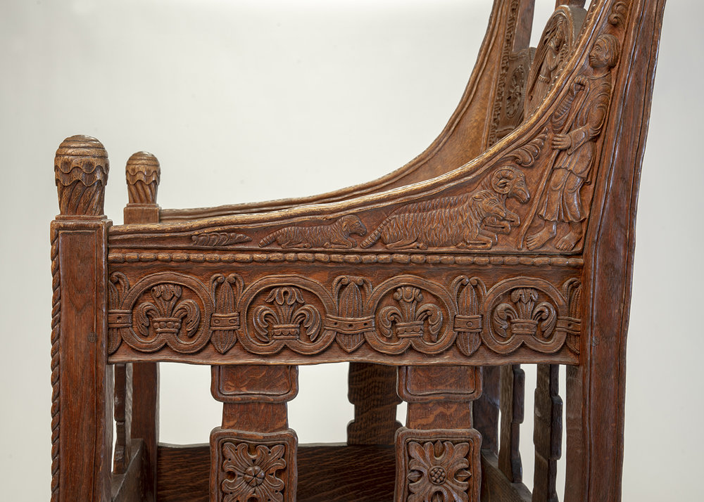 Figure 17: Bryn Athyn Cathedral Tyldal-style chair depicting a shepherd and his sheep. This chair also features a depiction of Samson slaying a lion (Judges 14:5)on the chair back (front side).